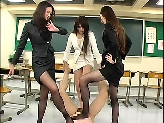 Elegant Oriental babes in pantyhose dominate with their feet