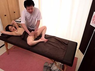 Luscious Japanese wife sexually satisfied on a massage table