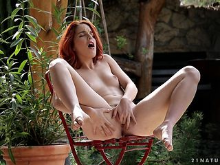 Redhead strips naked to give a close-up of her pussy hole in solo scene