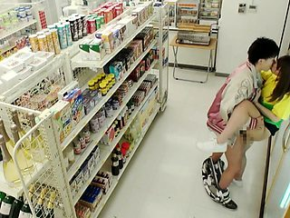 Naughty Japanese young lovers having sex in a public store