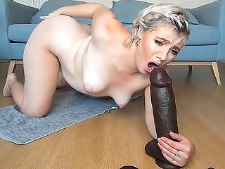 my horny neighbor plays with her new huge black dildo