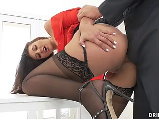 Secretary chokes on the janitors cock before he drills her round ass