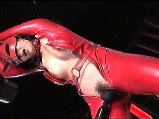Helpless Japanese babe in latex enjoys outstanding pleasure