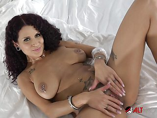 Tattooed Mara Martinez fingers her pierced pussy