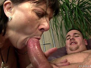 Mature pornstar with gigantic jugs finds her mouth filled with guy's sturdy schlong