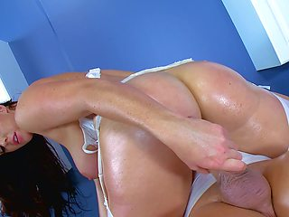 A black haired milf with a big ass is getting her ass rammed