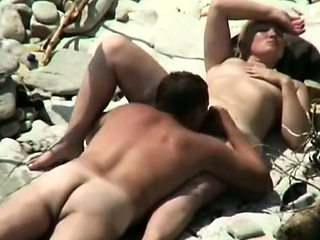 our nudist mom with her lover in the surf