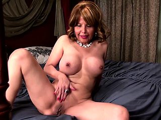 Horny American cougar fooling around in bed