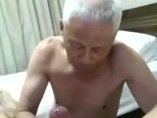 Nice chinese grandpa lying in bed and sucking dick