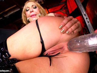 Lezdom anal in the dungeon with a big tittied mistress
