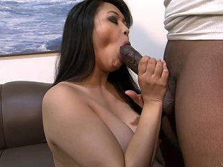 Brunette asian Mika Tan with giant melons her best to make her sex partner bust a nut