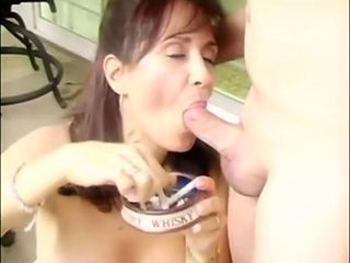 smoking Mommy in ff nylons gives a blowjob