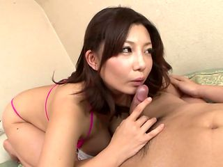 Japanese Milf Seduces in Bikini