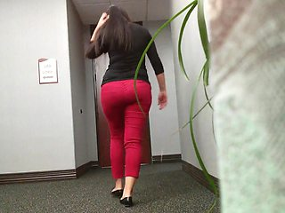 Latina in red tight pants and nice panty line ass