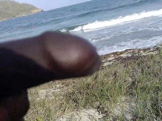 Charles Justin put his big black cock out in public beach