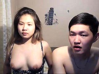 Busty Asian Wife Sucks a Big Hard Cock on webcam