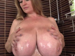 Sweet busty milf in the shower. Amazing big natural tits.