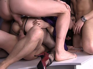 A chick in her pantyhose is getting penetrated with large dicks